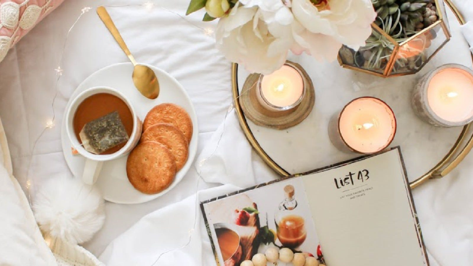 Candles, cookies, tea, and a journal from the Hygee Box.