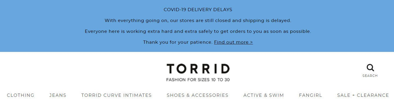 A splash page announcement alerting customers to COVID-19 delays on the Torrid website.