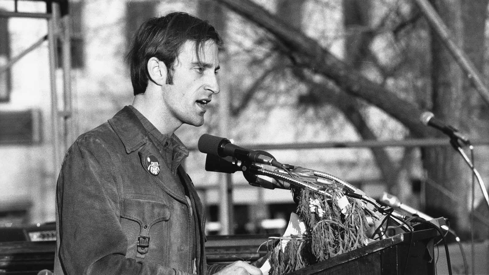 Denis Hayes speaking at a podium.