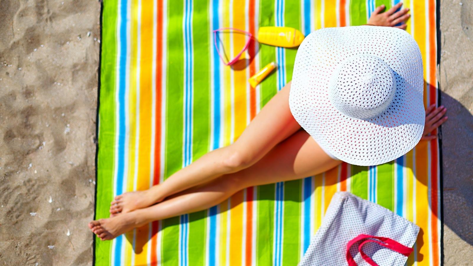 Woman sunbathing at the beach.