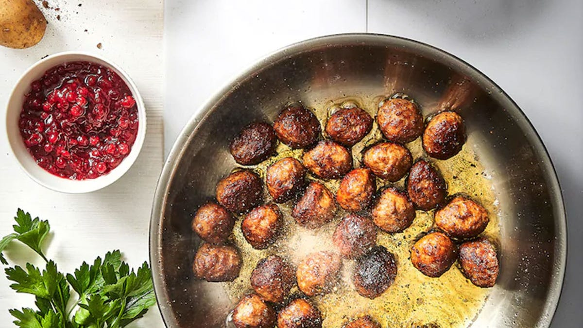 A pan of freshly made IKEA meatballs browning in a hot skillet.