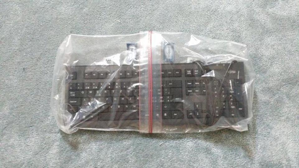 A keyboard sealed in two Ziplock bags.