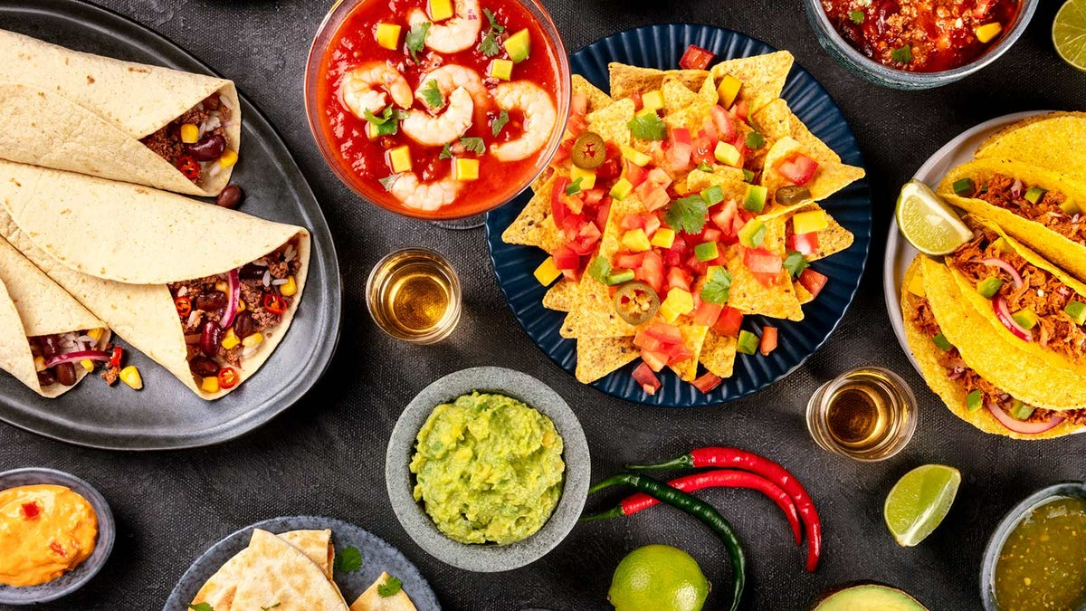 A table loaded with different traditional Mexican dishes.