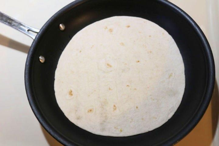A tortilla in a skillet.