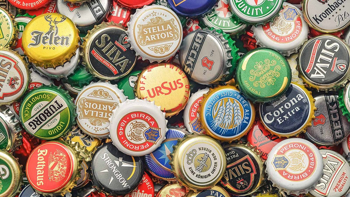 A pile of various beer bottle caps.