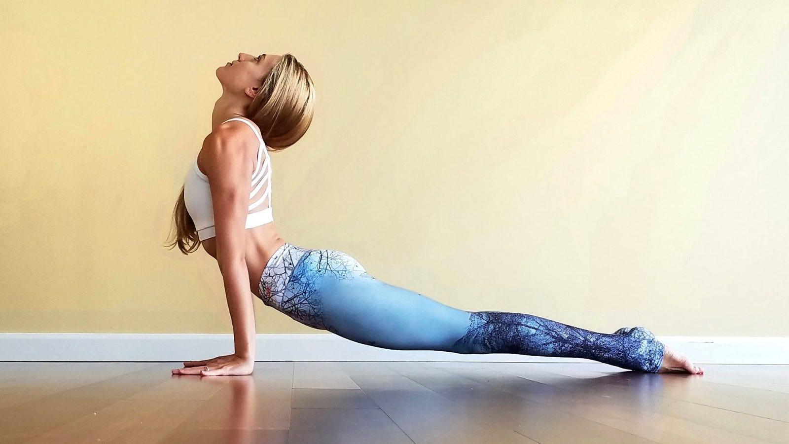 woman doing upward facing dog in yoga