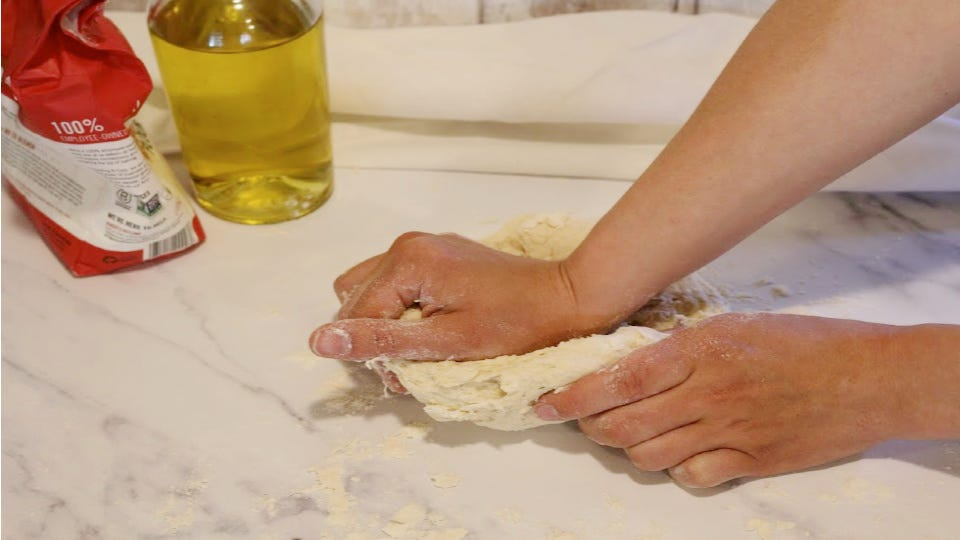 Kneading the remaining flour into dough.