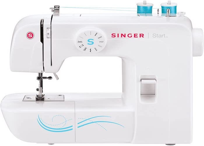 white sewing machine with bright blue and red accents and equipped with teal blue thread