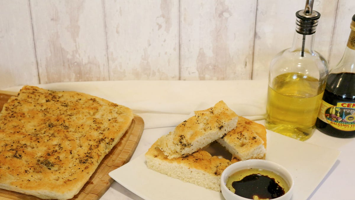 Freshly baked Focaccia bread, topped with garlic, and herbs, served with a small side of extra virgin olive oil and balsamic vinaigrette.