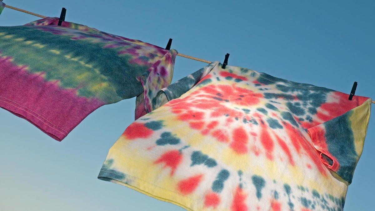 Tie dye shirts, hanging on a clothes line.