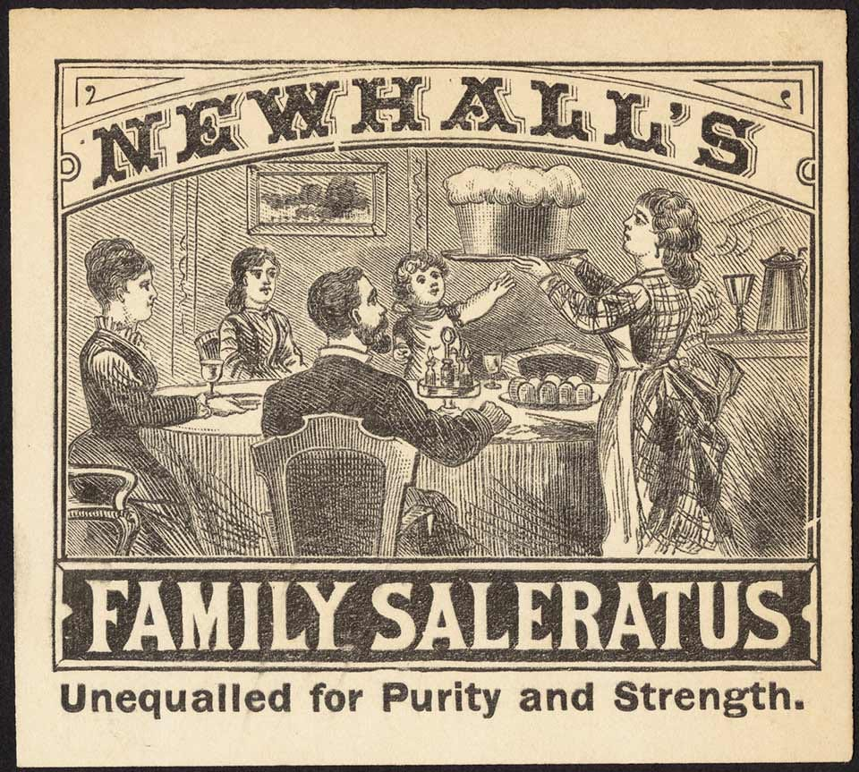 An early advertisement for baking soda featuring a family at a table marveling at a massive loaf of bread.