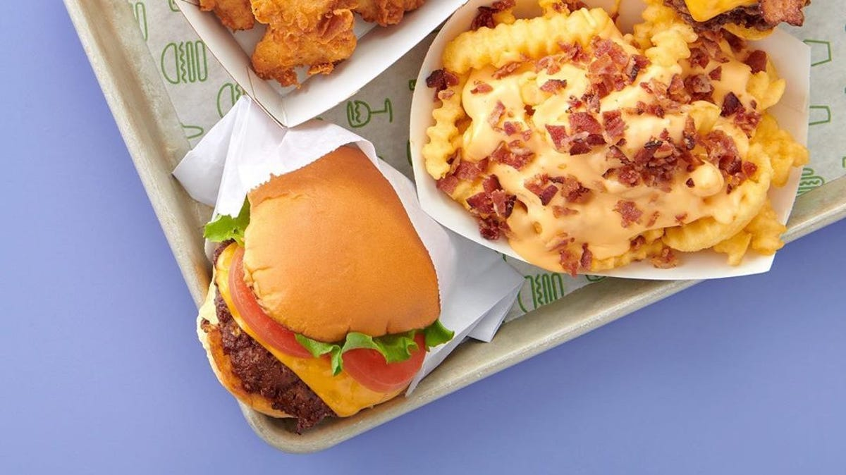 A burger and loaded cheese fries on a tray from Shake Shack.
