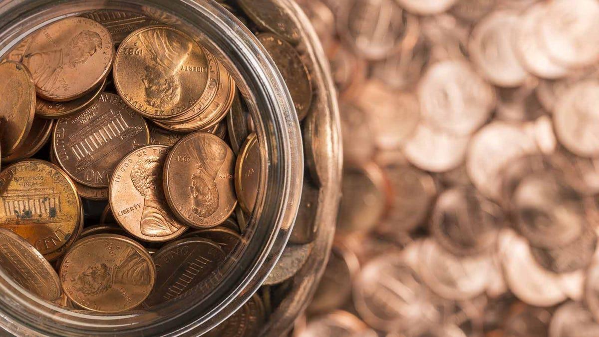 A jar of pennies in soft focus.