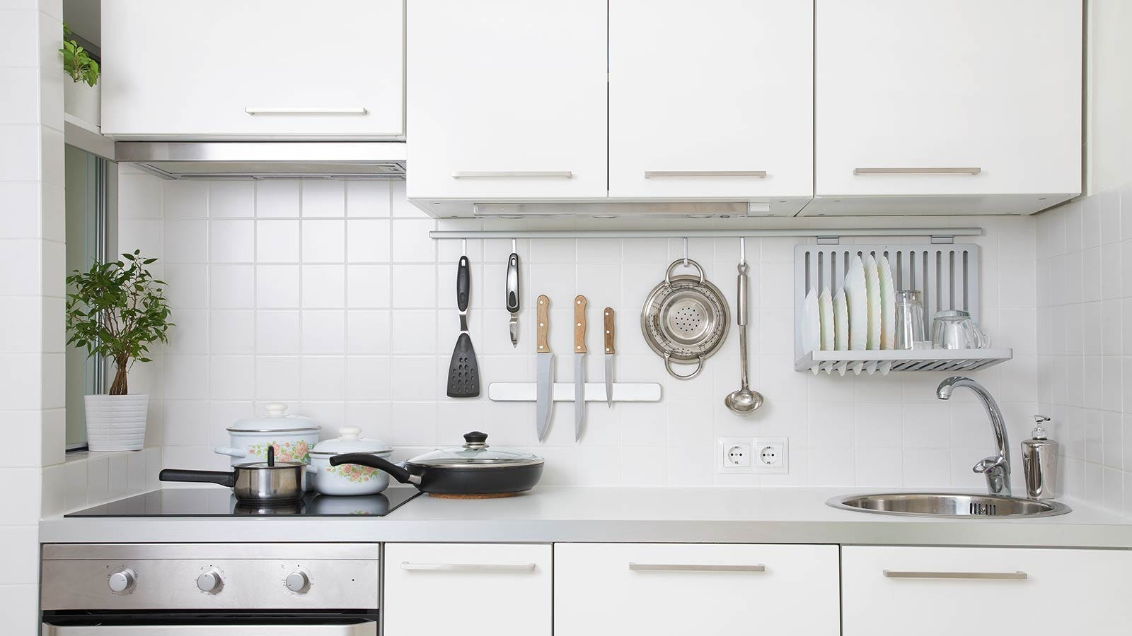 A small, well organized (and very white) kitchen.