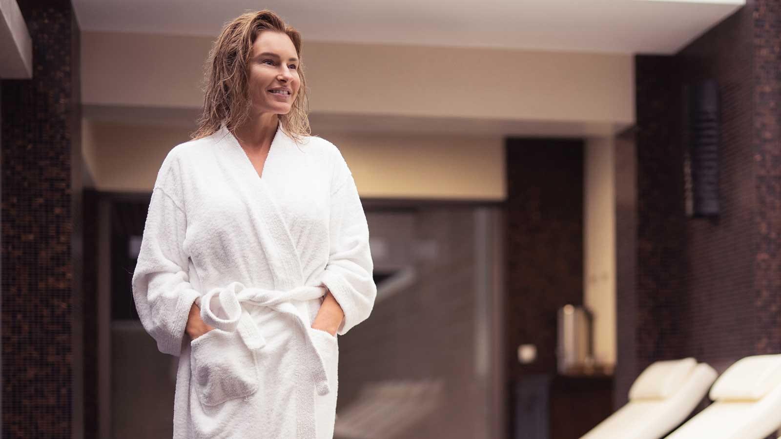 A woman wearing a comfortable bathrobe in a spa.