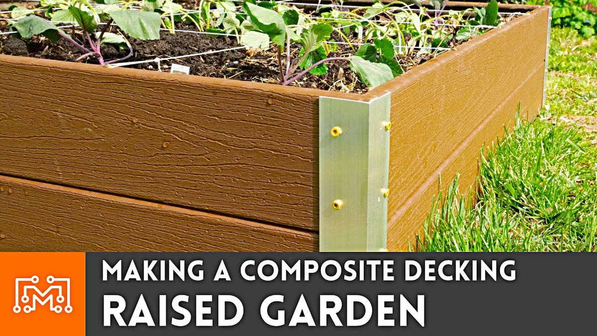 A closeup shot of the corner of a raised garden bed made from composite decking and aluminum angle irons.
