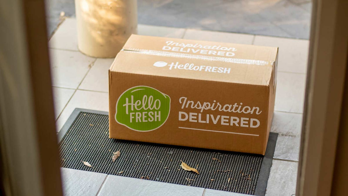 A Hello Fresh delivery box sitting on a front porch.