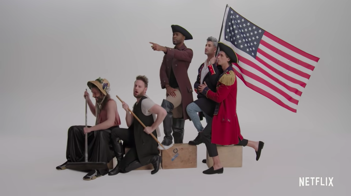 """The cast of """"Queer Eye"""" posing as the figures in the """"Washington Crossing the Delaware"""" painting."""