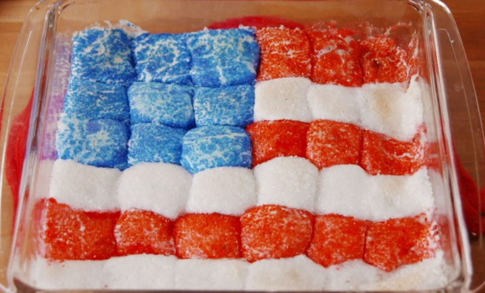A casserole dish of July Fourth S'mores Dip decorated to look like the American flag.