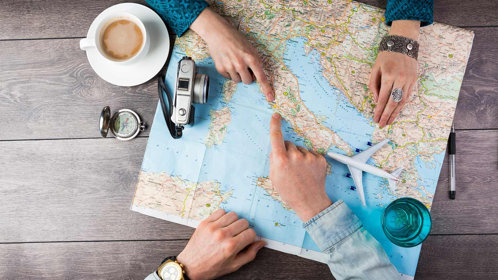 A couple planning a trip using a paper map.