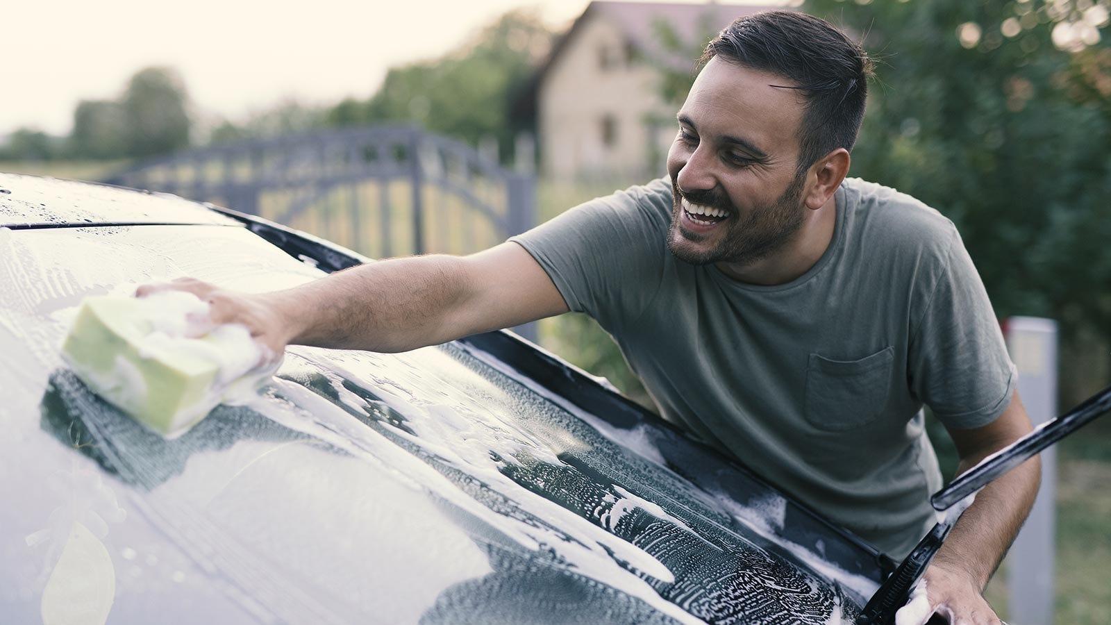 Man washing his dad's car.