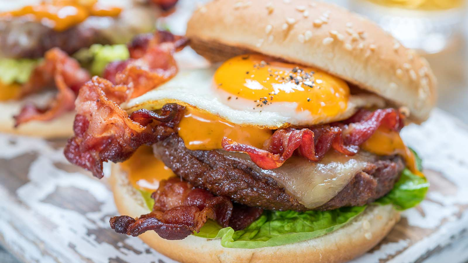 A hamburger topped with bacon and a fried egg.