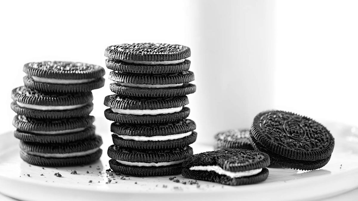 Stacks of Oreo cookies on a plate.