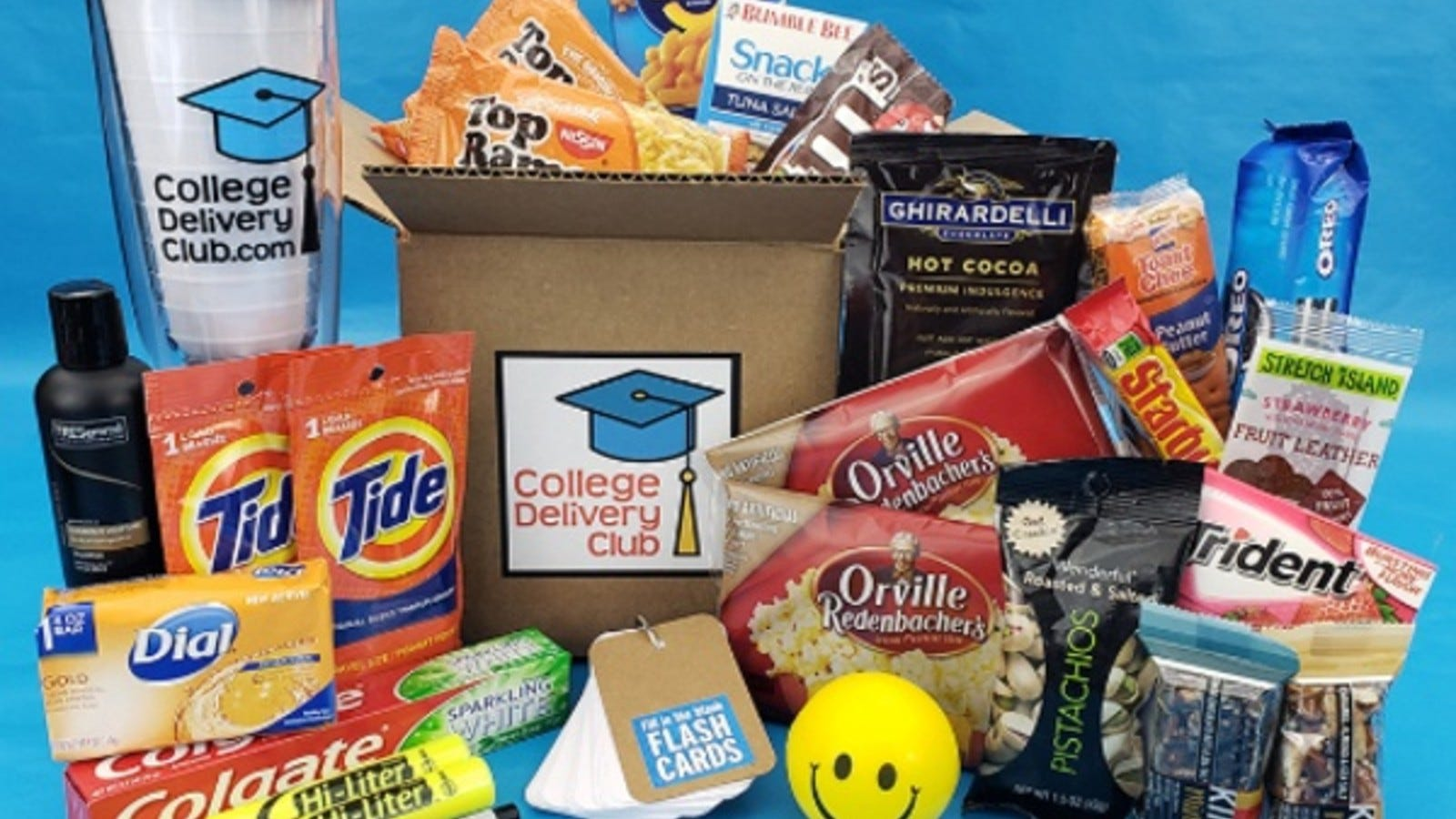 A College Delivery Club box surrounded by its contents.