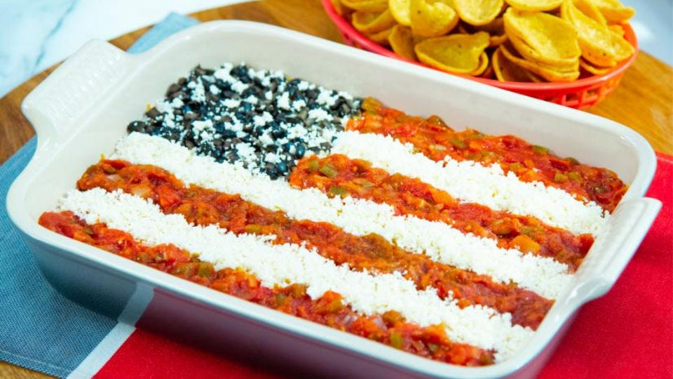 A layered bean dip decorated to look like the American flag.