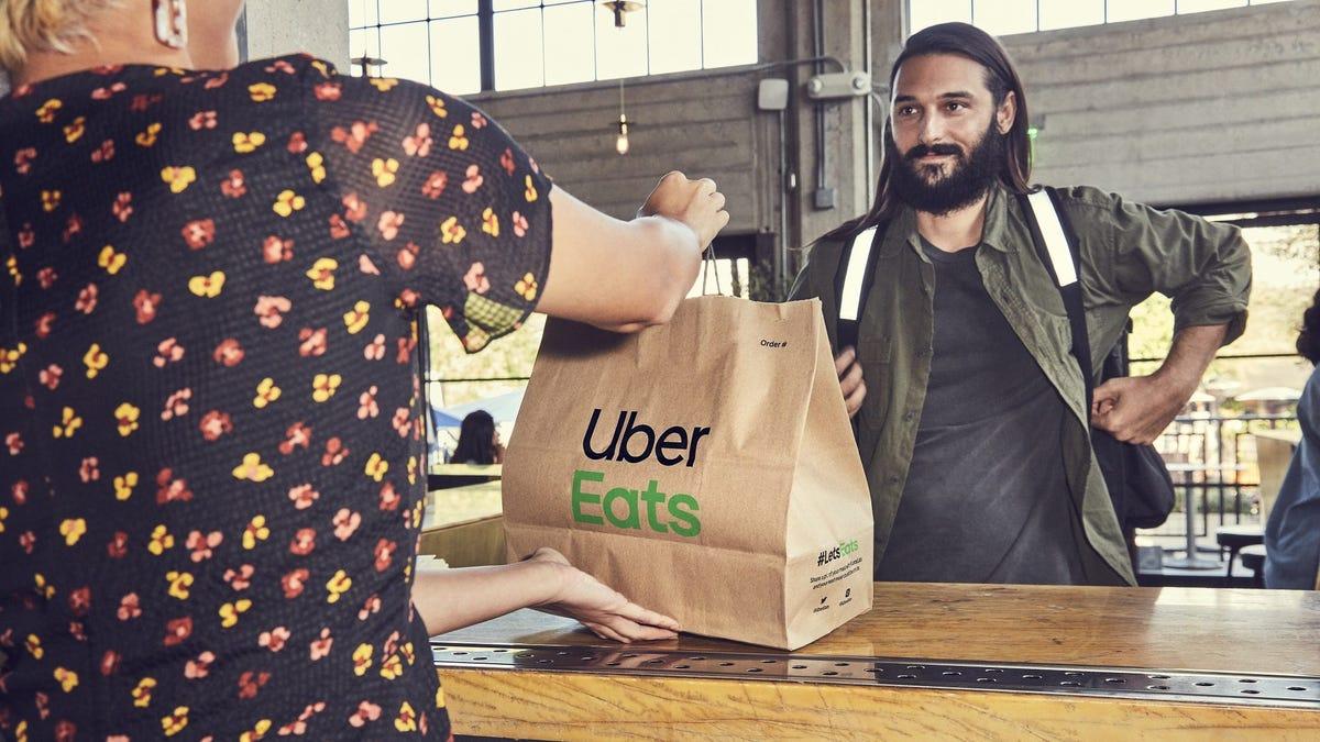 A driver picks up an Uber Eats order.