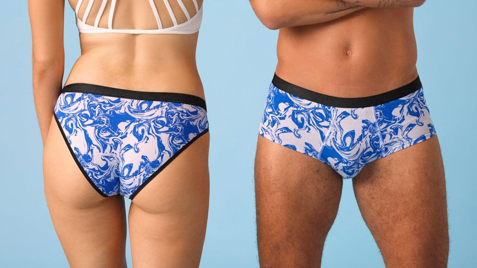 A woman and man wearing matching pairs of underwear from MeUndies.