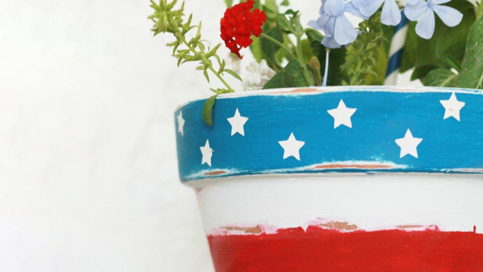 A flower pot painted with stars and stripes.