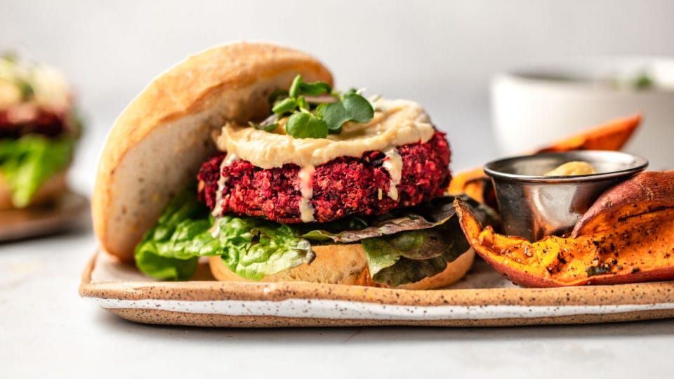 A beet burger with a side of sweet potato fries.
