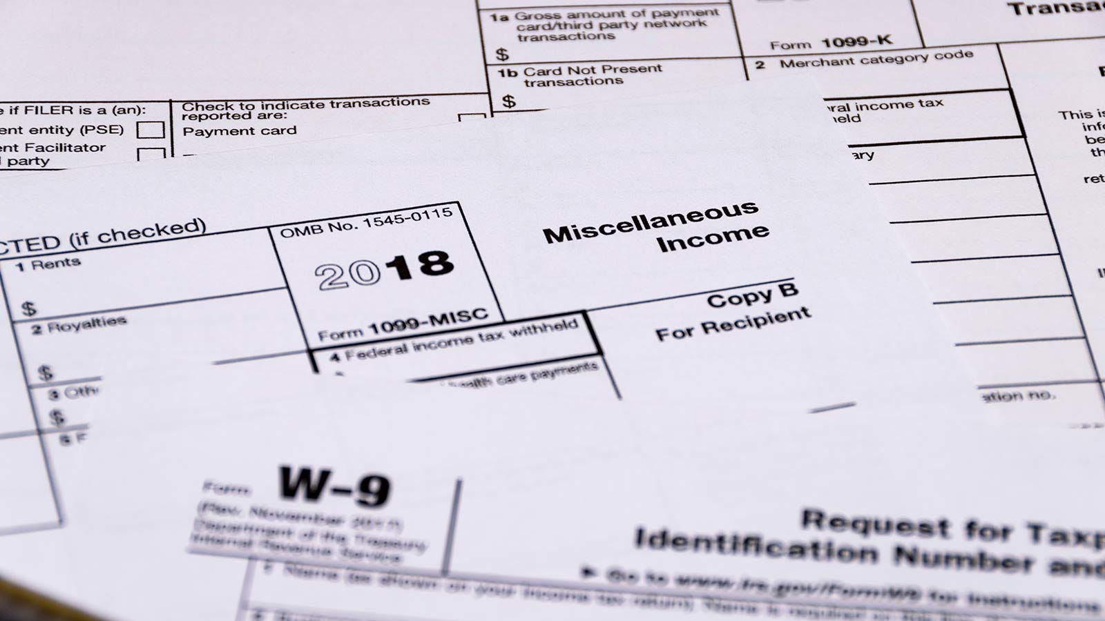 Miscellaneous IRS tax forms spread out on a table.