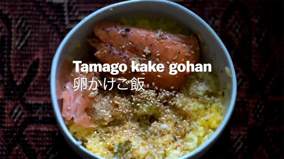 A photo of a traditional Japanese breakfast, tamago kake gohan.
