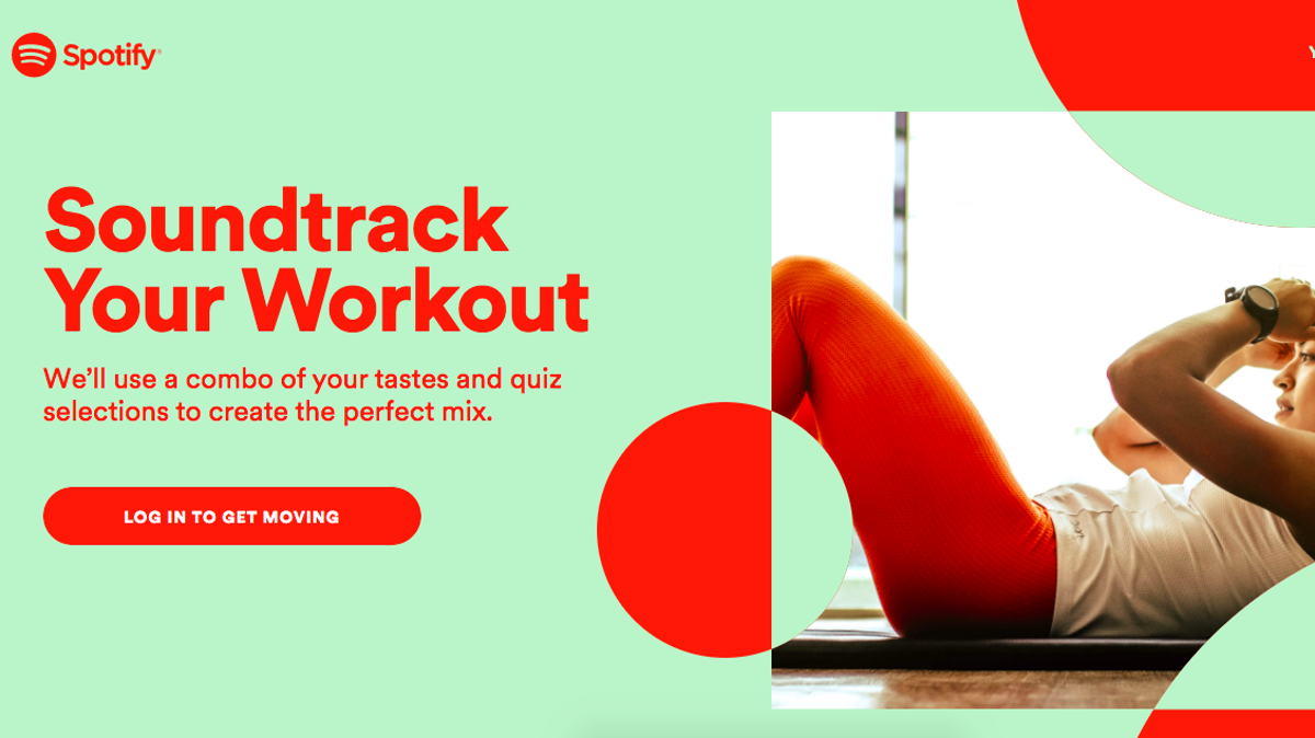 A woman works out next to a sign for the Soundtrack Your Workout feature from Spotify.