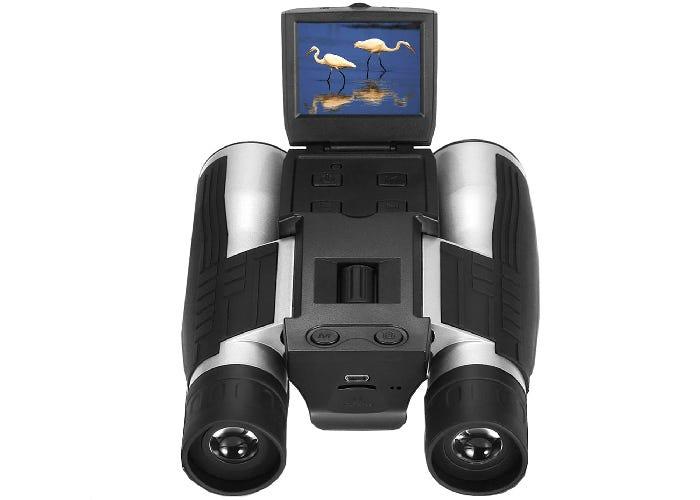 black camera binoculars showing cranes on the screen