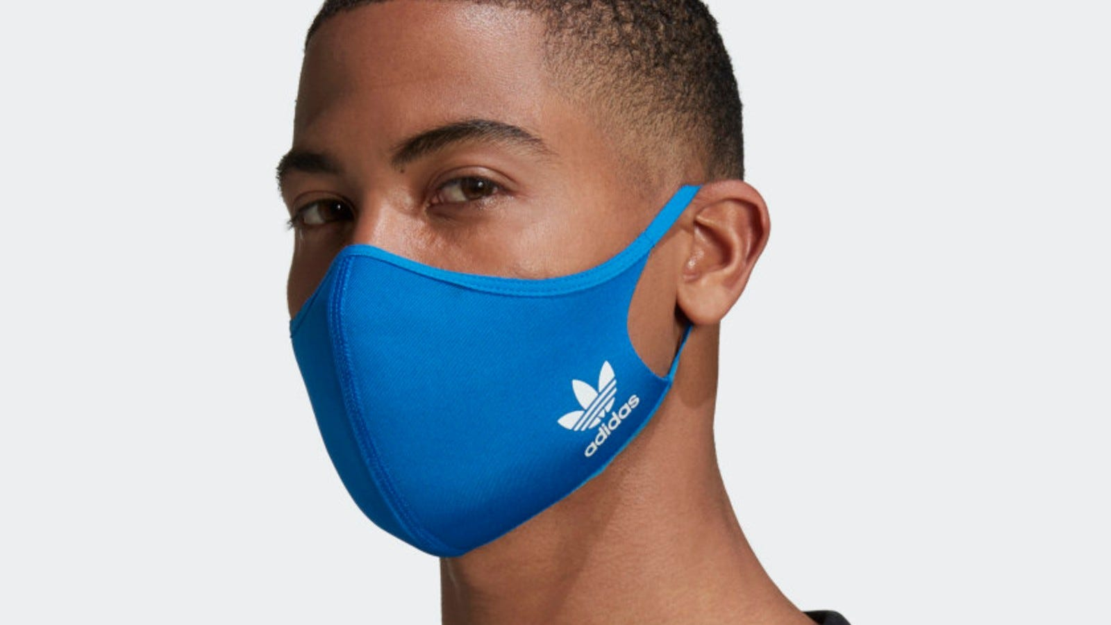 A man wearing a blue Adidas Face Cover.