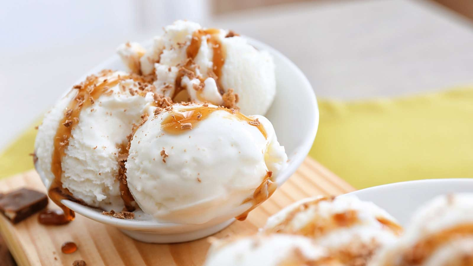 Vanilla ice cream, striped with caramel on top.