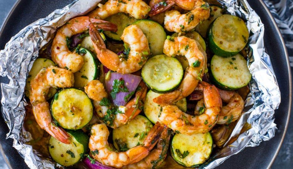 Grilled shrimp and vegetables, in a foil packet.