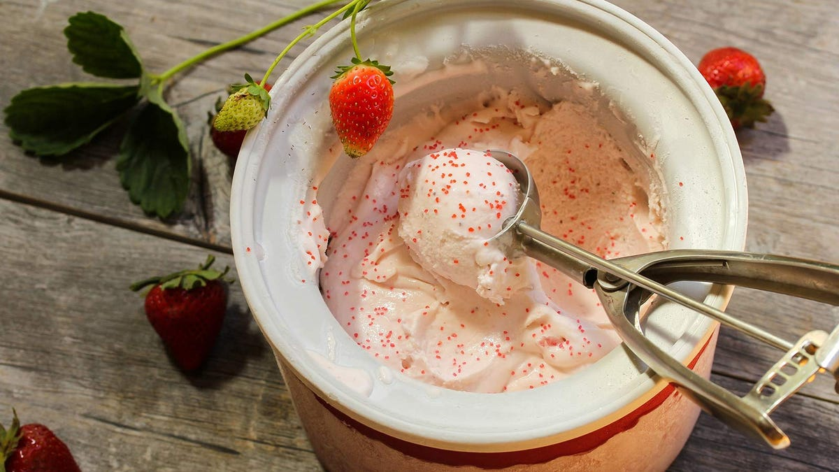 Homemade strawberry ice cream, sprinkled with tiny red candy sprinkles.