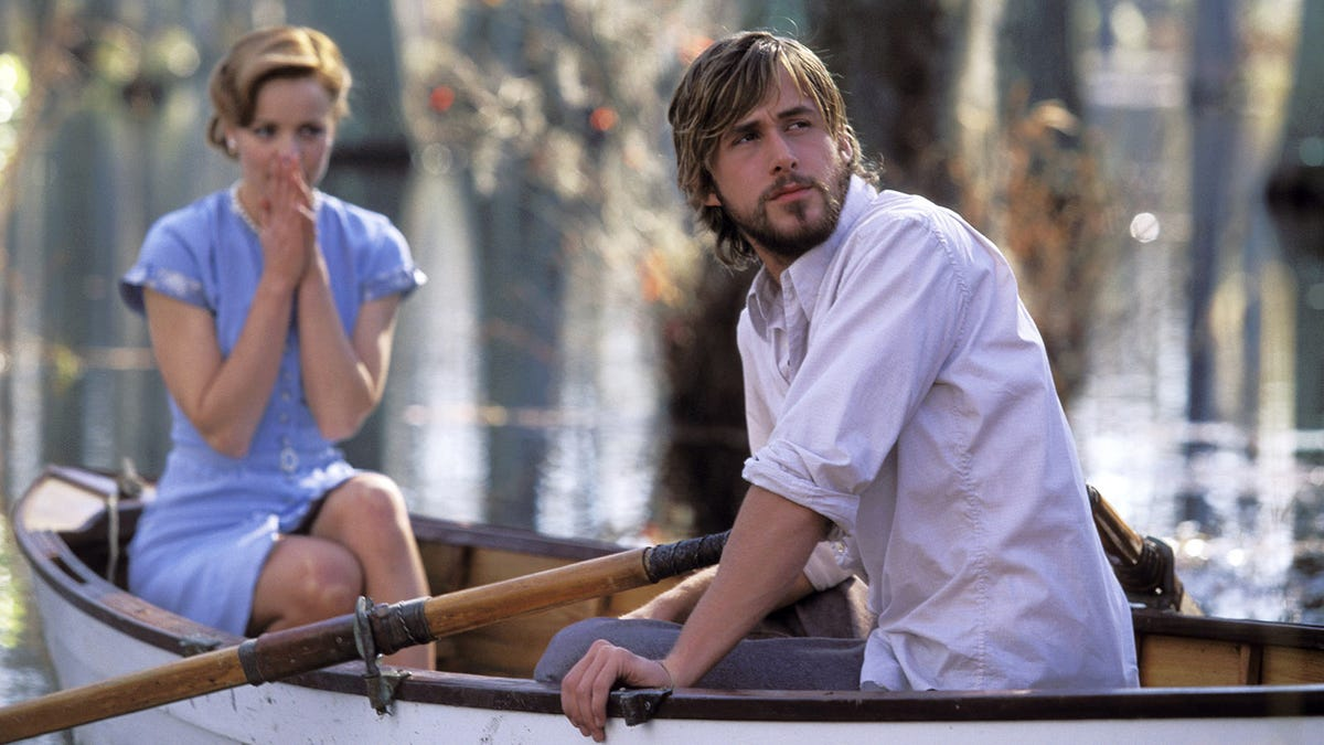 A scene from the 2004 movie adaptation of The Notebook with the main characters in a row boat.