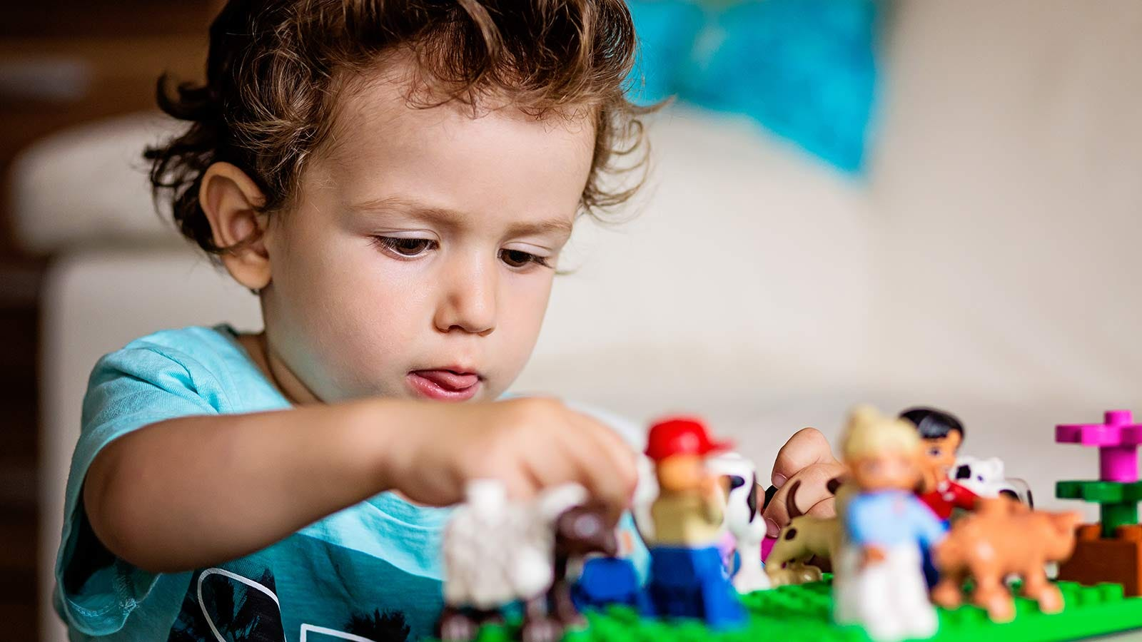 A young boy playing with LEGOs.
