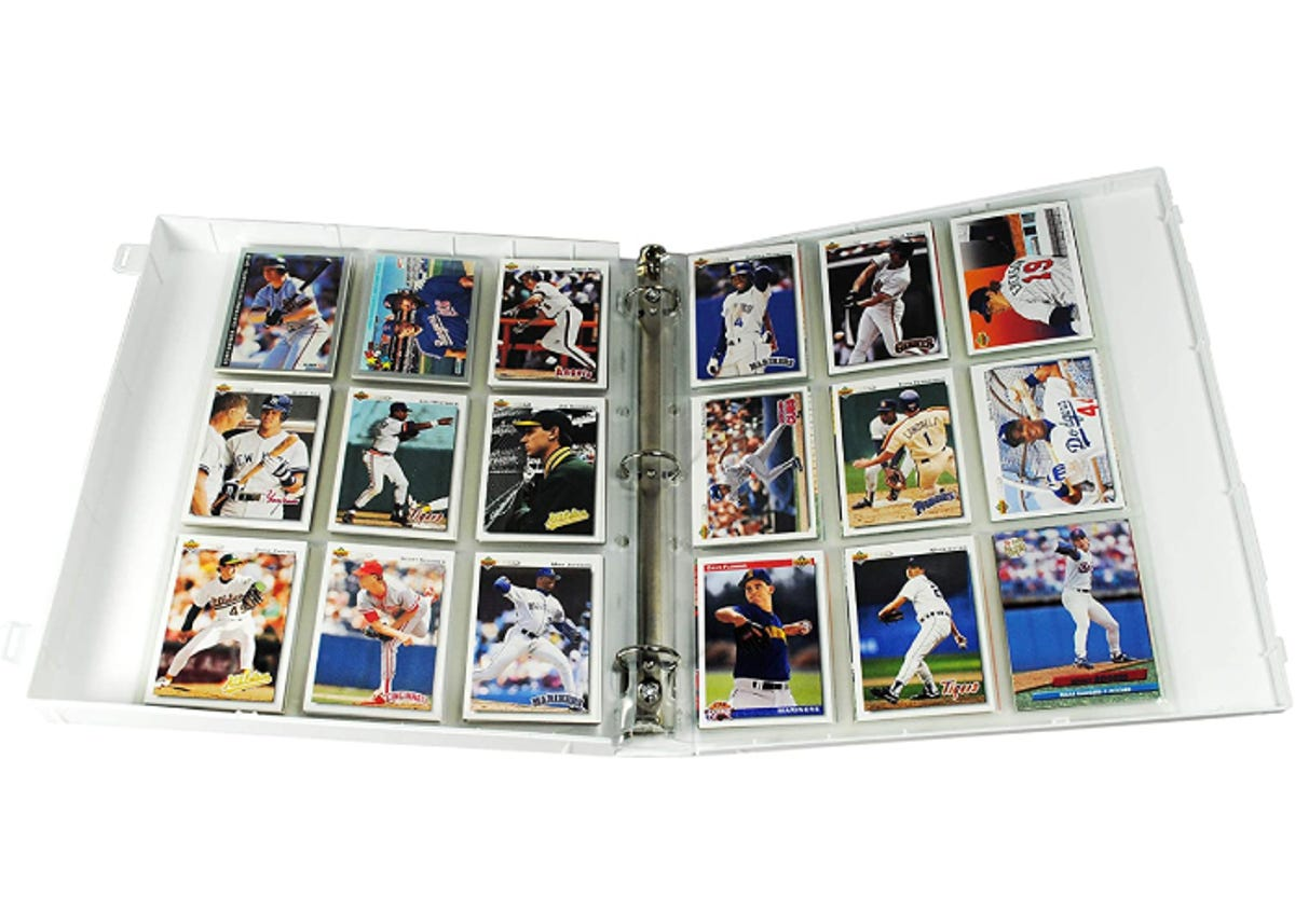 baseball cards in plastic sleeves in a white binder