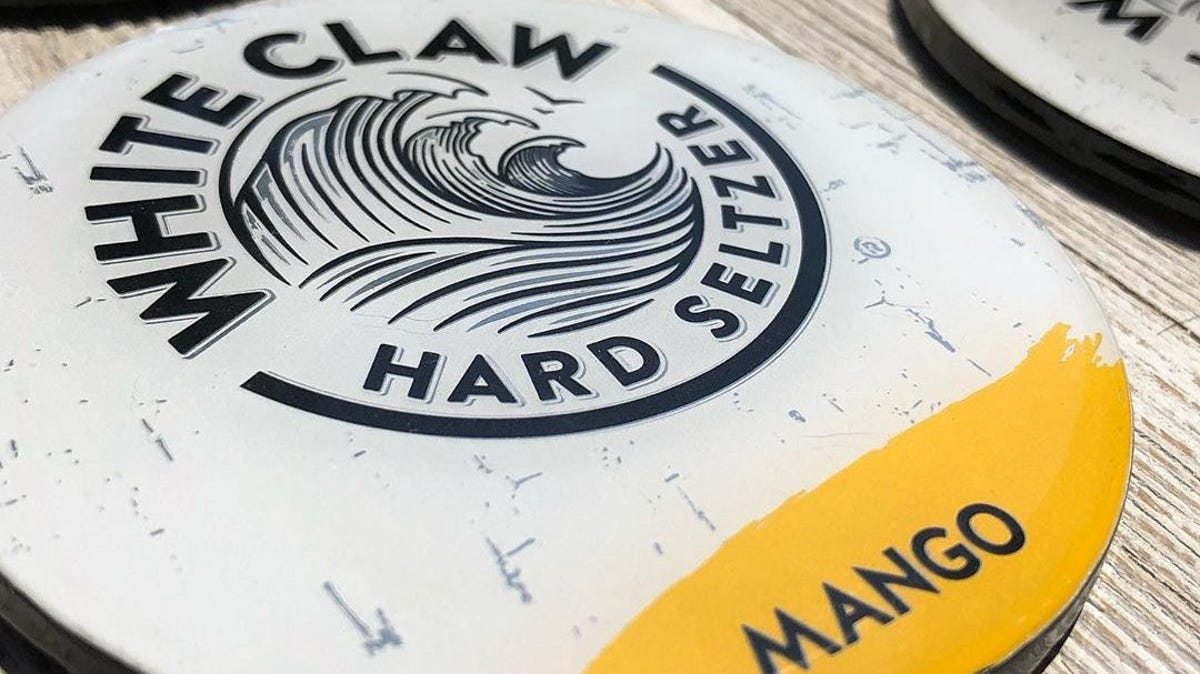A white claw can has been turned into a coaster.