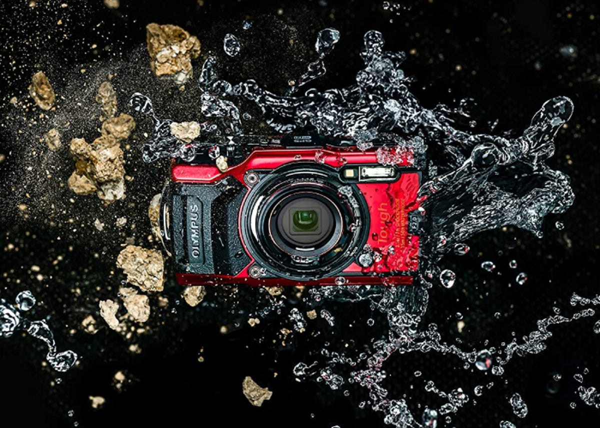 red and black waterproof camera on a black background