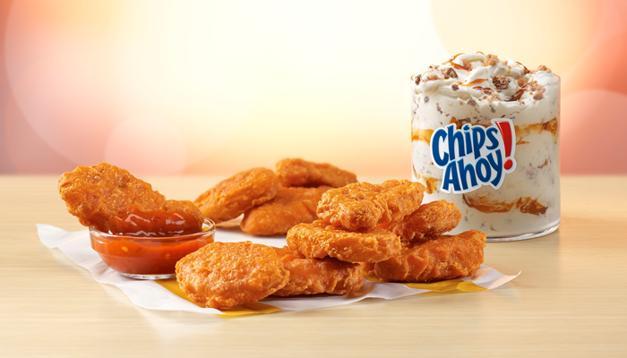 McDonald's Spicy Chicken McNuggets are piled together in front of a McFlurry.