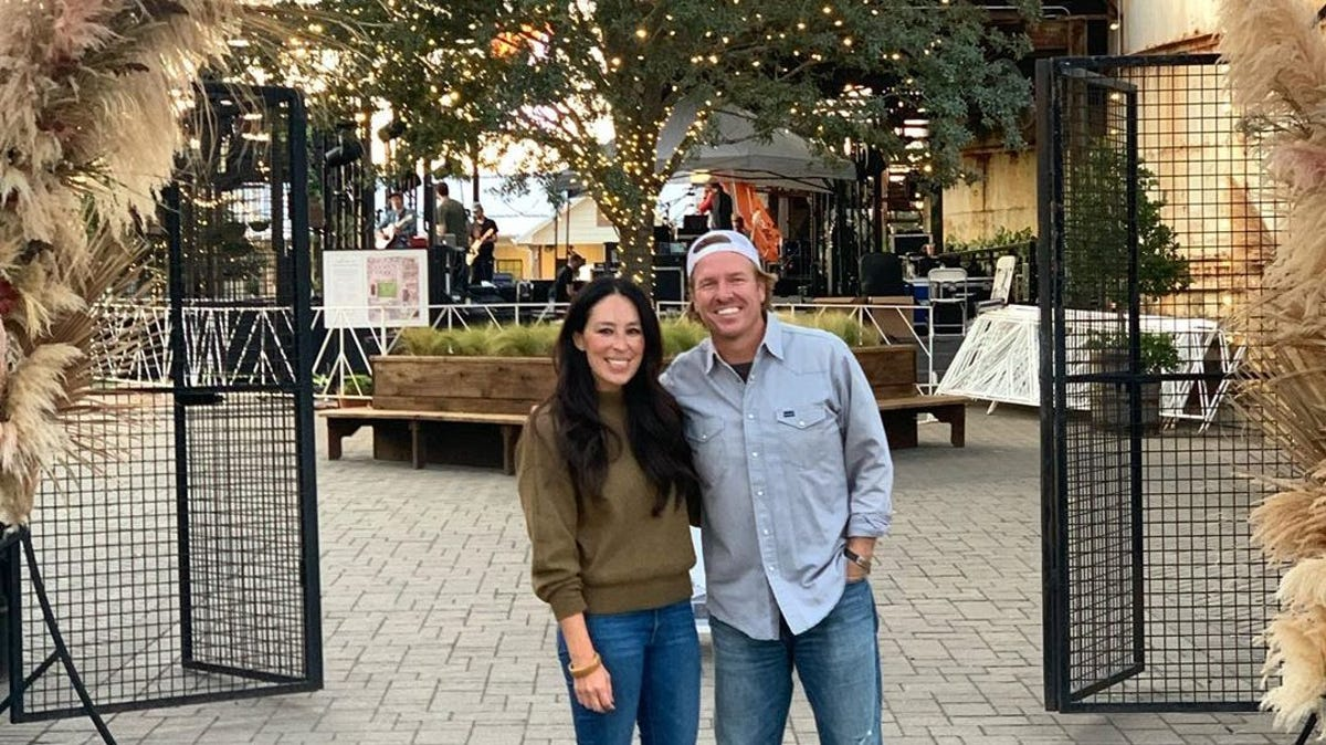 Chip and Joanna Gaines stand outside of their Silo shopping center in Waco
