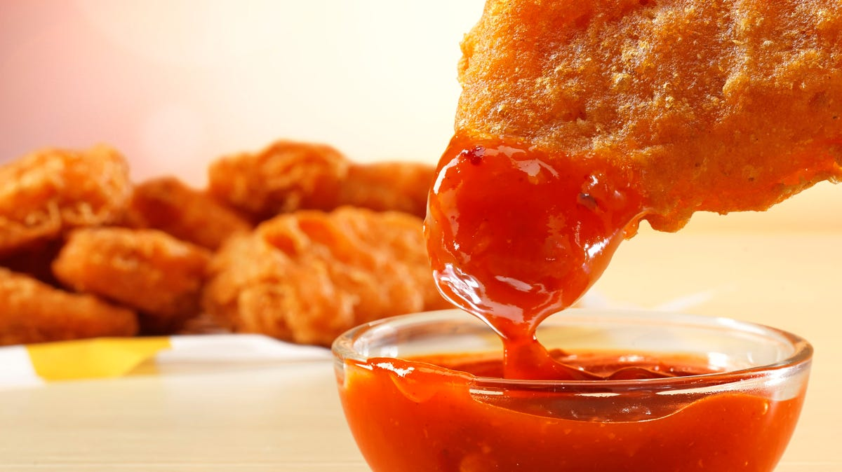McDonald's new spicy chicken mcnugget is dipped in hot sauce.