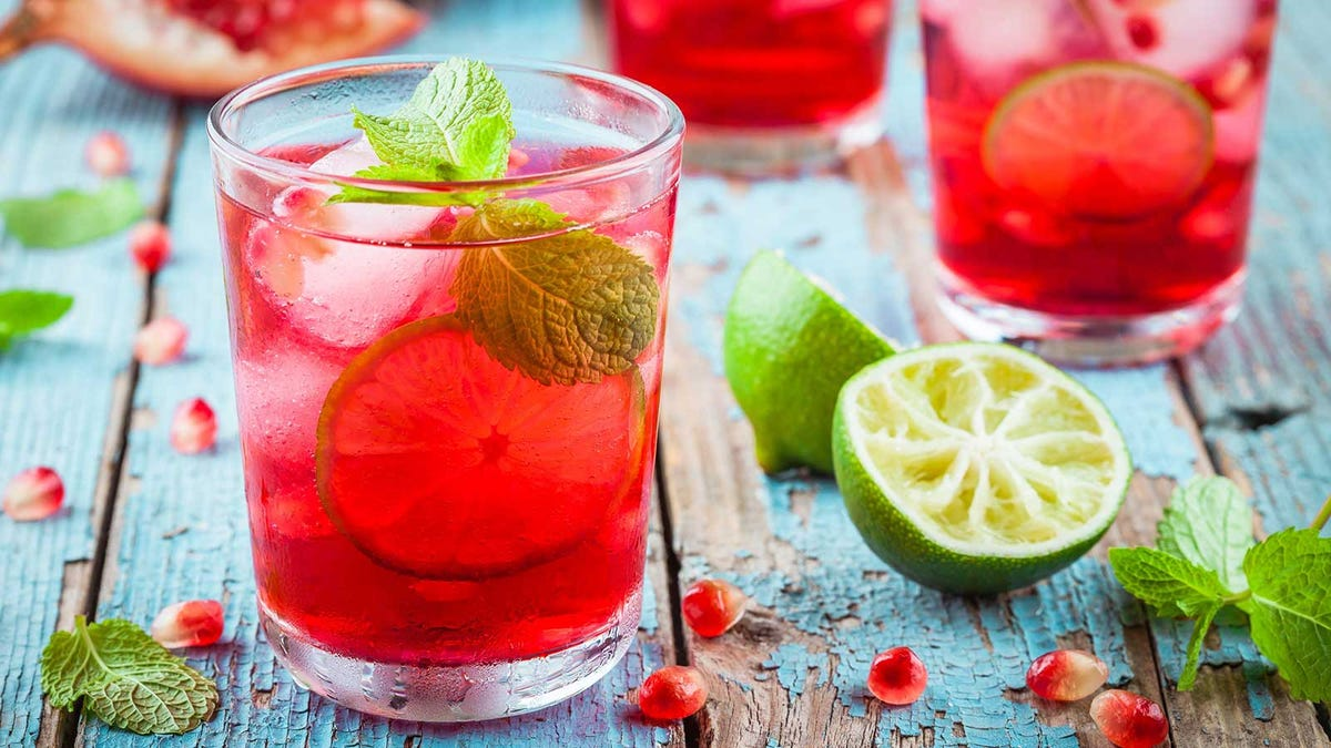 A lemonade-based mocktail, flavored with mint, lime, and pomegranate.